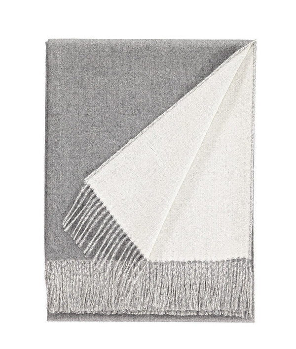 Detail of Woven light grey and white reversible Baby Alpaca soft blanket designed in the UK by So Cosy