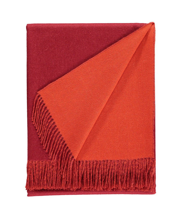 details of Woven red and burnt orange reversible Baby Alpaca soft blanket designed in the UK by So Cosy