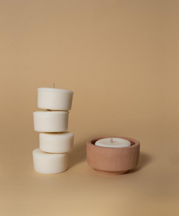 naeba handmade rapeseed vegan tealight candles with essential oils in a terracotta holder