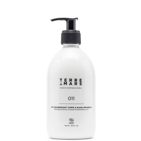 glass bottle containing 011 imminence body and hand nourishing milk by French organic skin care brand Terre de Mars