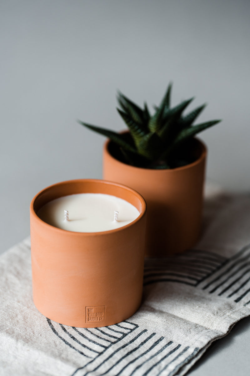 Lifestyle Handmade rapeseed vegan candle with essential oils in a handmade terracotta reusable pot indio