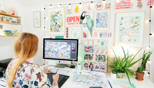 Jacqueline Colley colourful Studio Office in London with vibrant posters and illustrations made by her on the walls