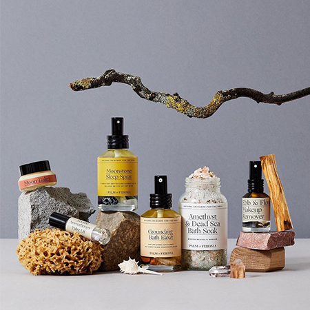Product range of holistic brand Palm of Feronia with natural skin products such as the grounding bath elixir or the amethyst and dead sea bath soak