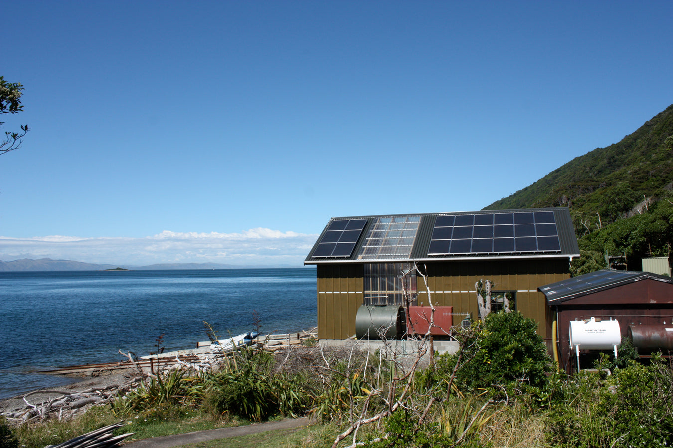Off Grid Solar Array On Secluded Residence with Oceanic Backdrop