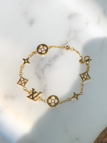 IDYLLE BLOSSOM MONOGRAM BRACELET, YELLOW GOLD AND DIAMONDS