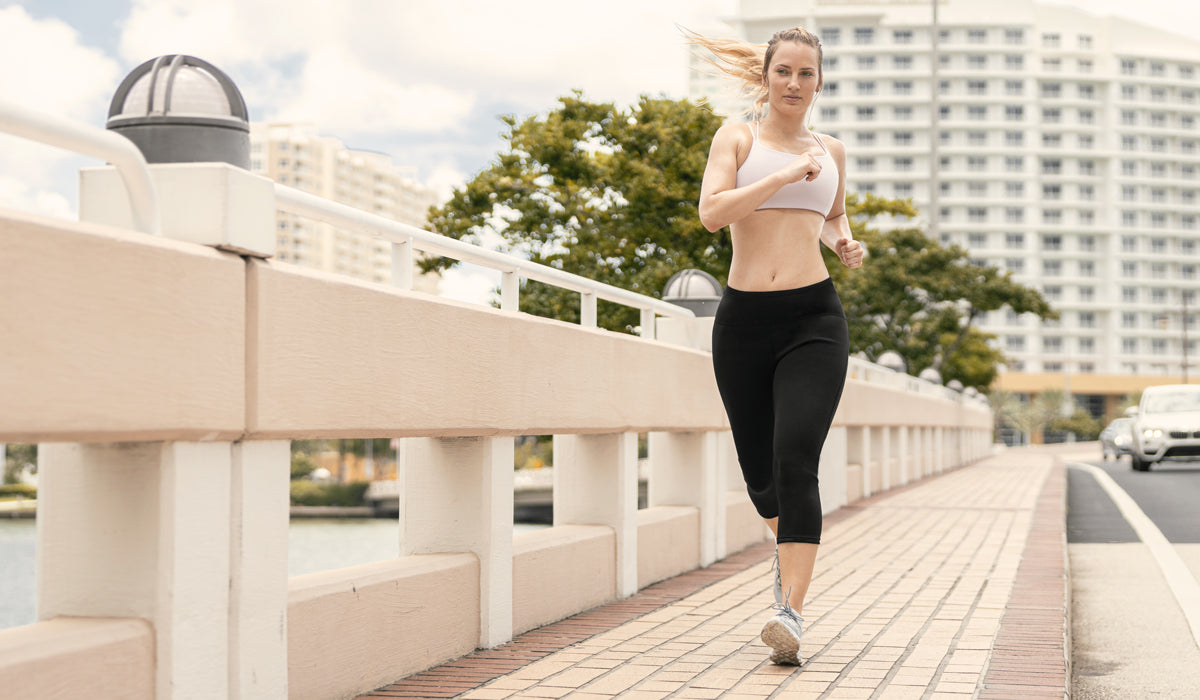 woman running and sweating with her Copper Slim Pants