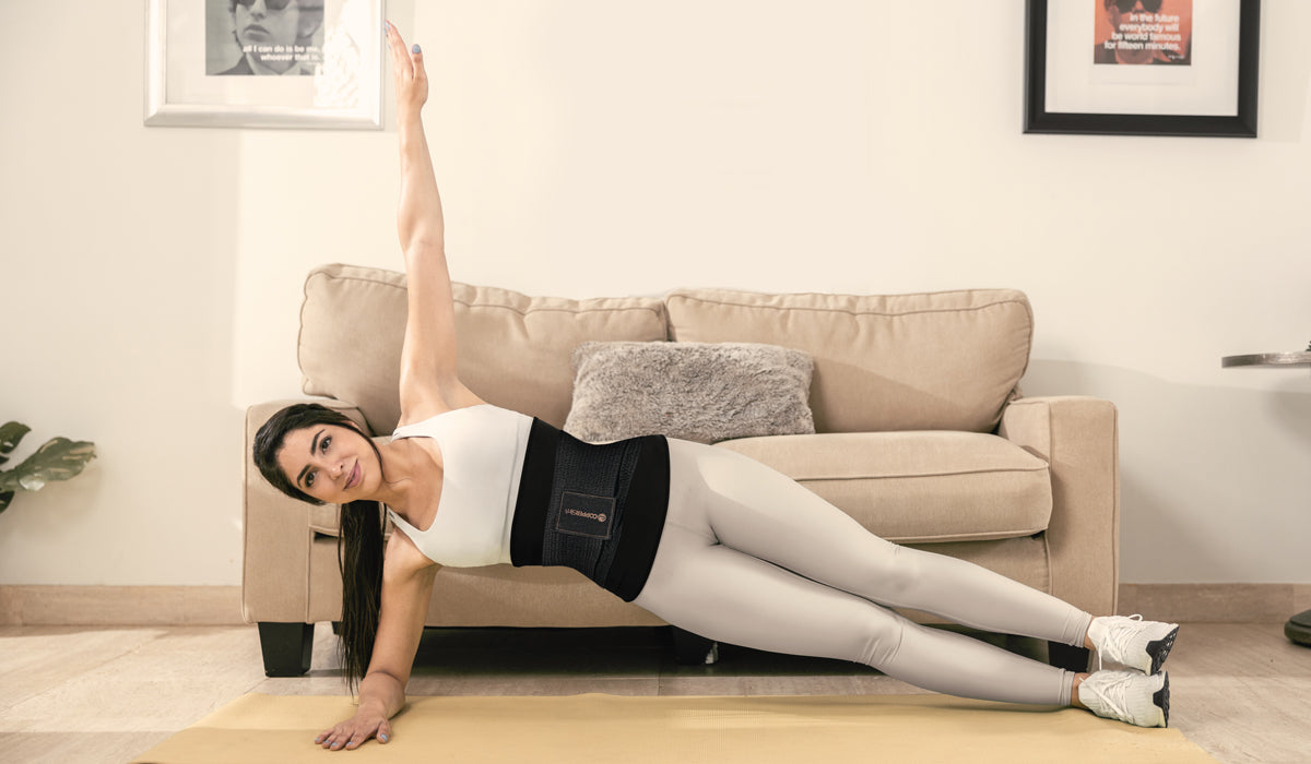woman exercising to have a smaller waist with her Copper Slim Belt with Waist Trainer
