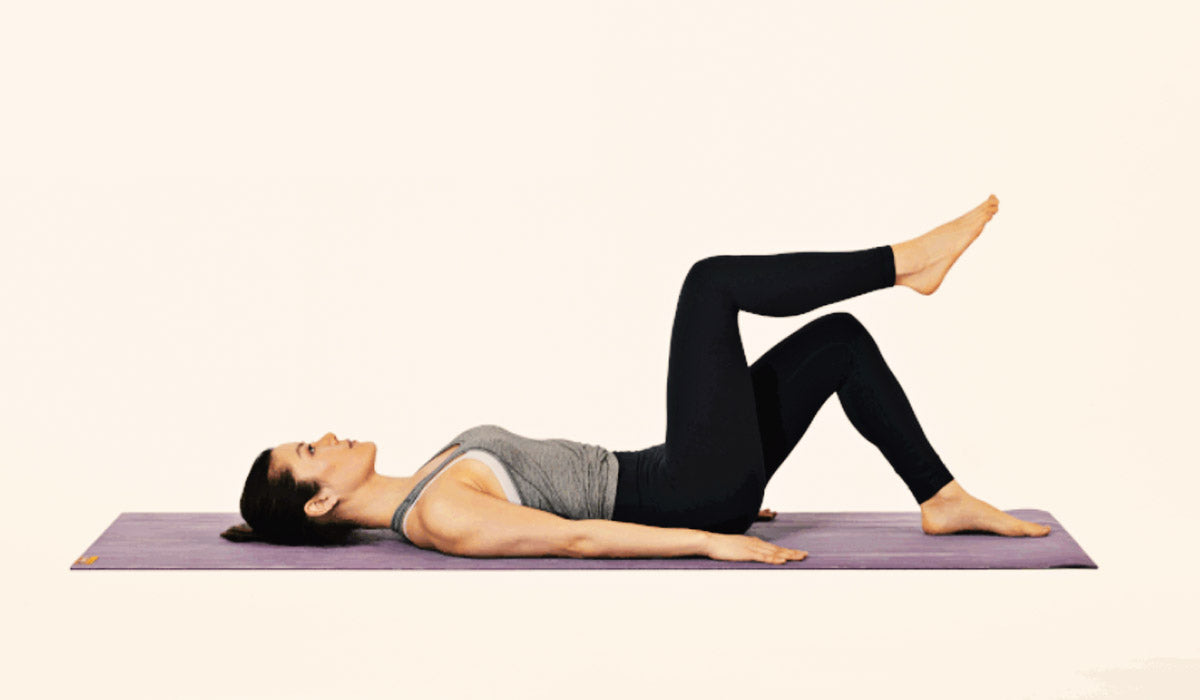 woman doing supine toe tap exercise