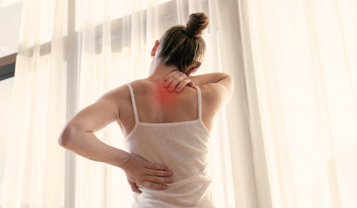 woman with back and neck pain