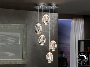 Five small ceiling lamps hanging together from a black chrome base in living room.