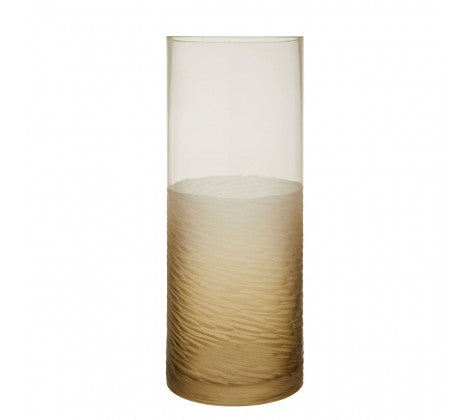 A small, textured and grey glass cylindrical designed vase on a white background.