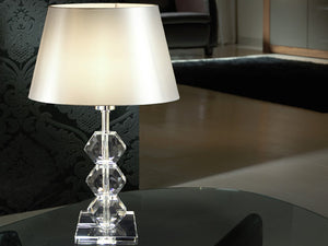 Elegant glass table lamp with a chrome finish, resembling an hourglass style.