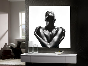 Large square artwork of woman holding herself on a white background, drawn to resemble strong metal.