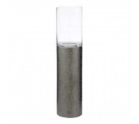 Small delicate candle holder, made of a grey metal which glitters in the light.