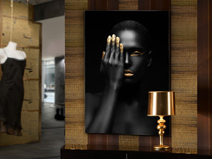 Large portrait artwork of a woman in black wearing golden lipstick and nail polish, very dark in design.