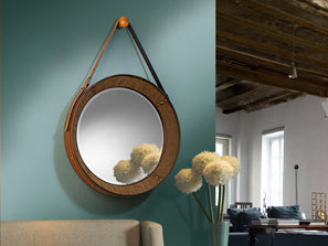 Medium sized circular mirror, strong style which resembles a porthole hung from brown leather.