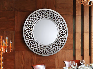 Large simple circular mirror, bordered with small stars and has a silver finish.
