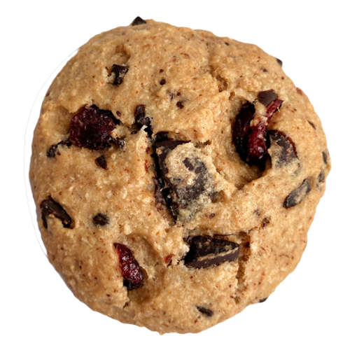 a round cookie with chunks of dark chocolate and cranberry