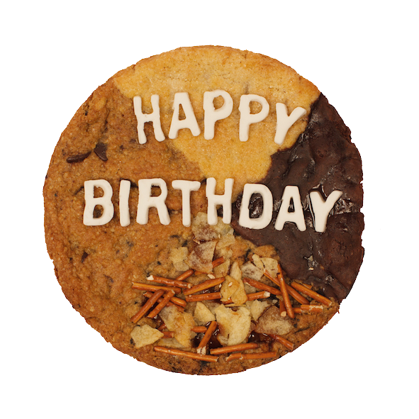 large cookie cake with multiple flavors that says Happy Birthday on top