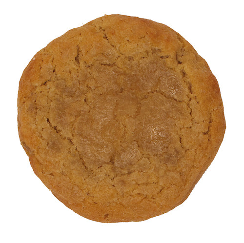 a dark golden ginger cookie with a spread of ground up ginger candy on top
