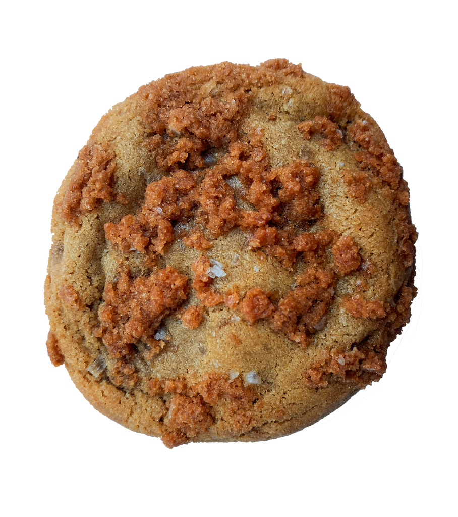 a round golden butterscotch cookie topped with bits of butterscotch and sea salt