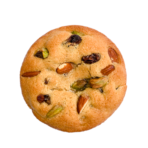a round golden cookie topped with a mix of nuts and raisins