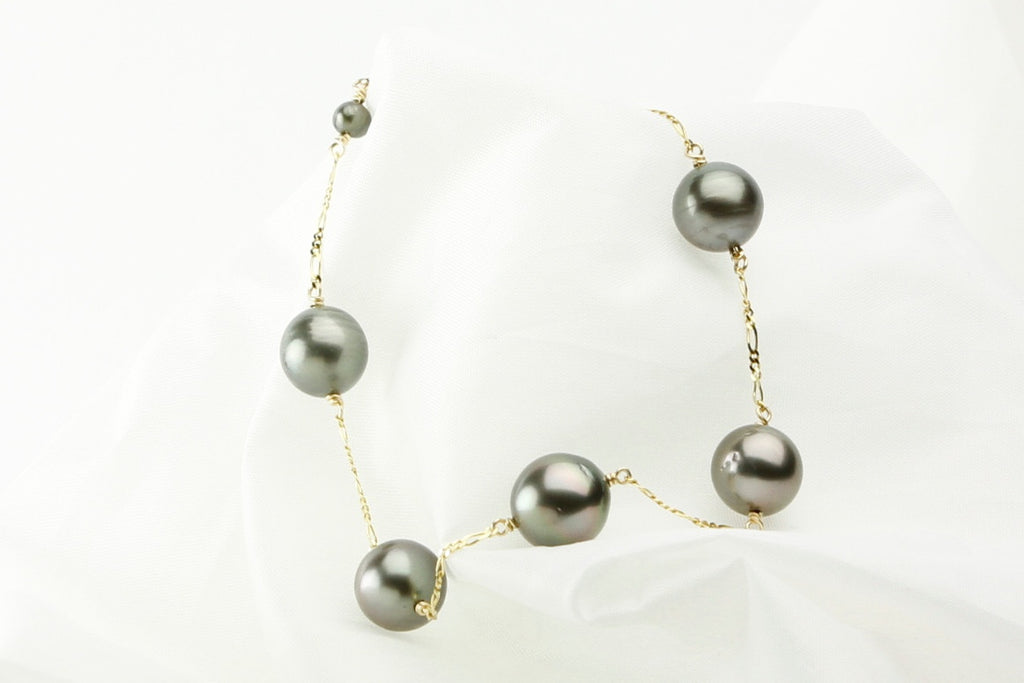 Five pearl tin-cup bracelet