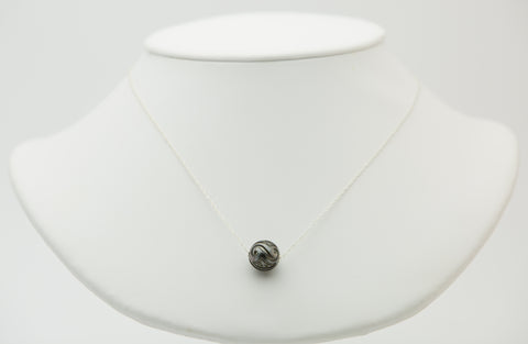 Carved Tahitian pearl slider floating necklace