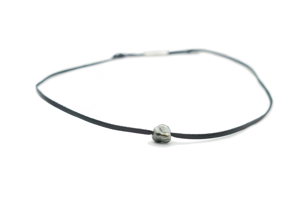 Tahitian keshi pearl and leather necklace
