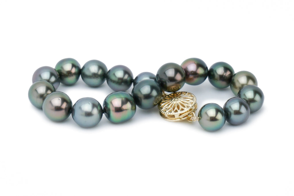 Colorful dark semi-baroque Tahitian pearl braclet