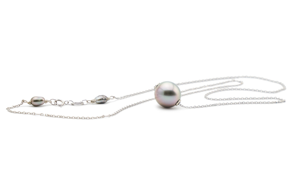 Pink blue opalescent Tahitian pearl slider necklace on white gold