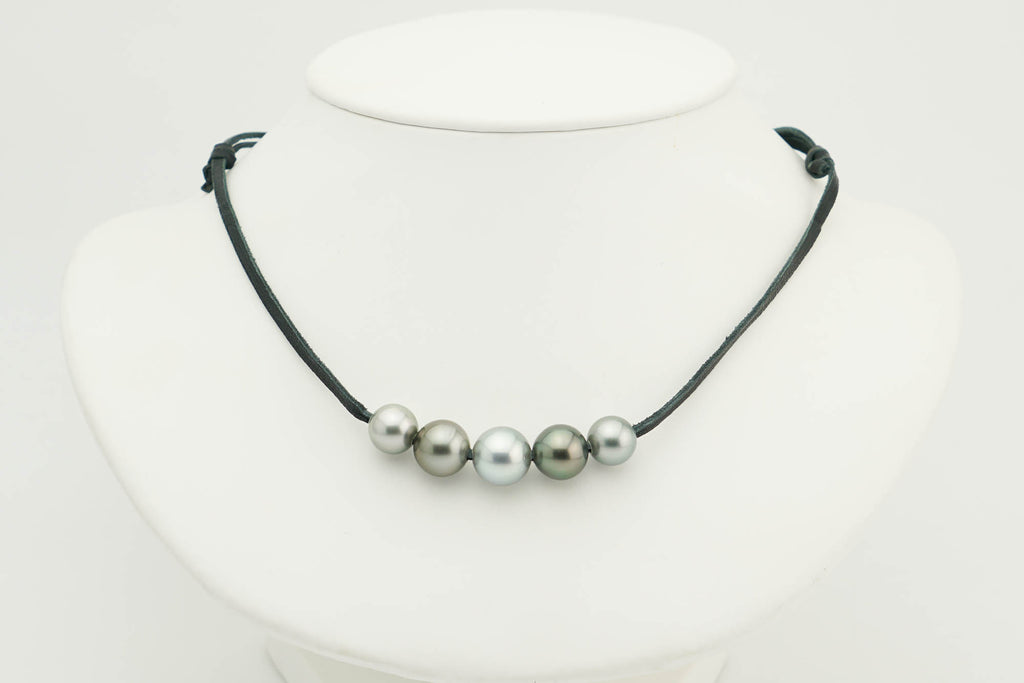 Five Tahitian round pearls on leather necklace