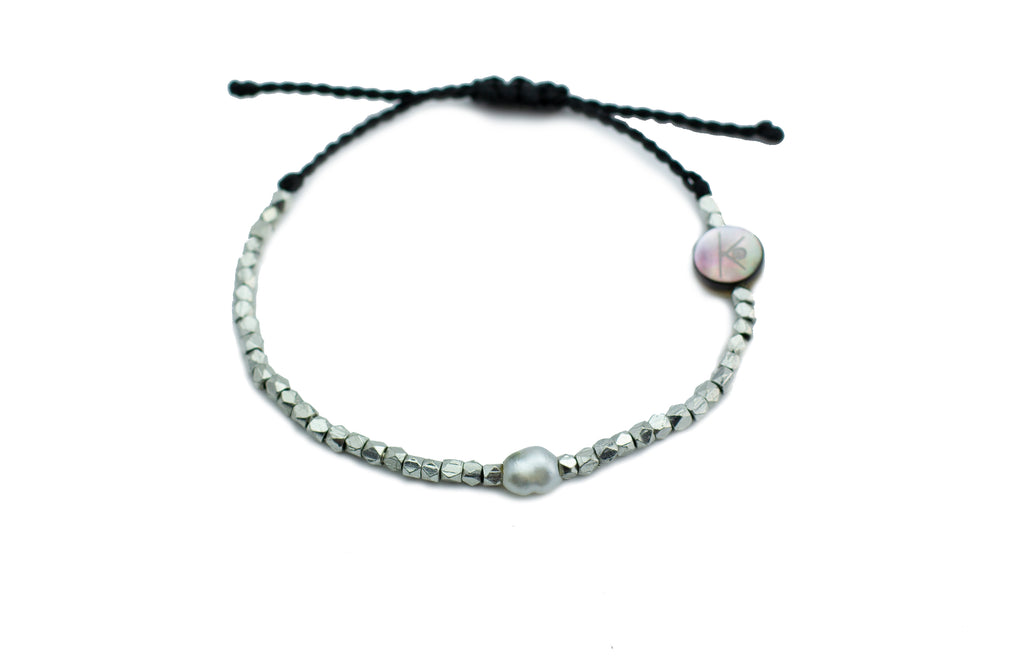 Tahitian keshi pearl and silver beaded adjustable knotted bracelet