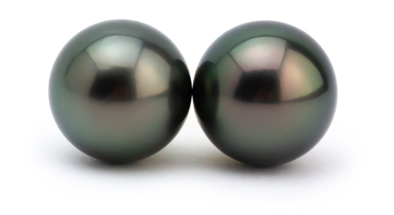 Kamala Harris Tahitian pearl earrings 12mm dark green peacock
