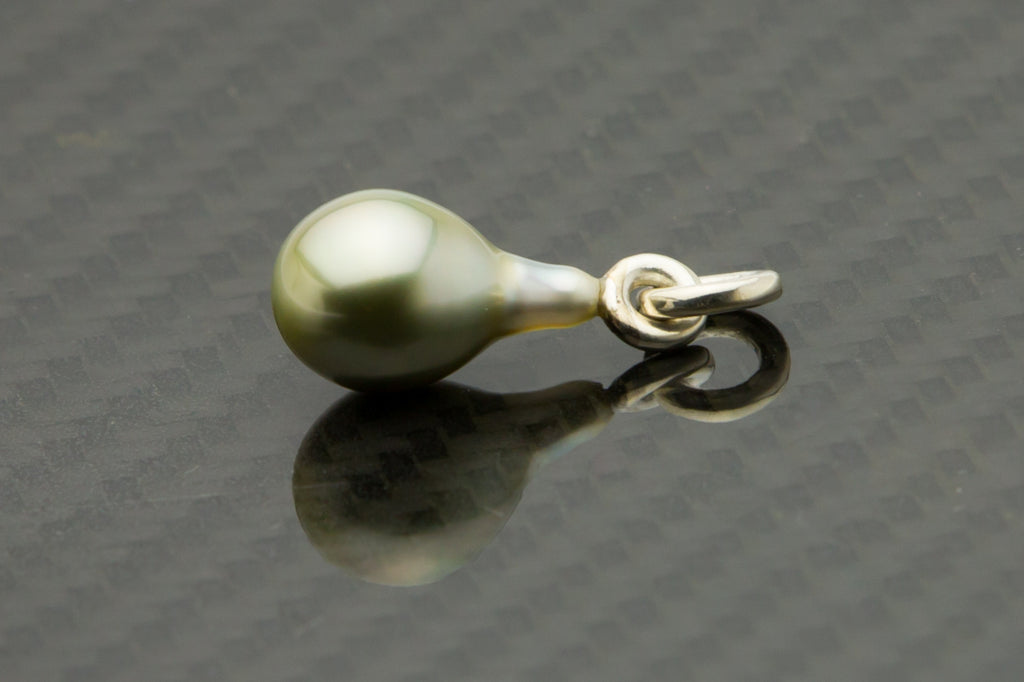 Golden pear shaped Tahitian pearl on silver