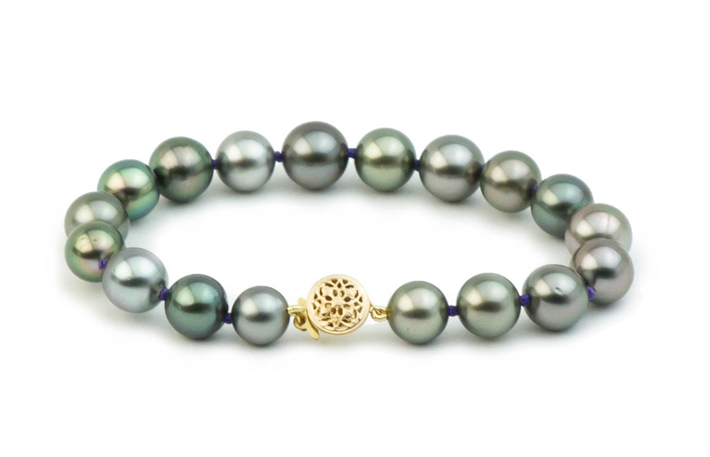 Blue green Tahitian pearl bracelet on purple thread