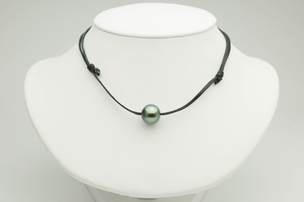 Bright green 13.5mm Tahitian pearl on kangaroo leather necklace
