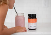 Girl drinkings smoothie with New Zealand Honey Co. Manuka honey UMF 10+ in it