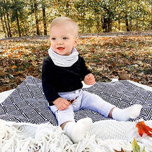 Bazzlebaby warmth collection includes baby infinity scarf style drool bib and travel stroller blanket with clips and fuzzy polyester fleece back.