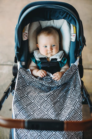 Bazzle Baby travel stroller blanket with clips. GoBlanket in black and white diamonds.