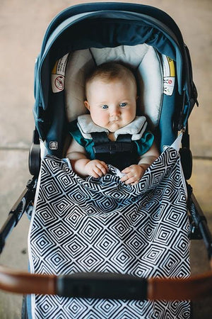 Travel stroller blanket with clips.