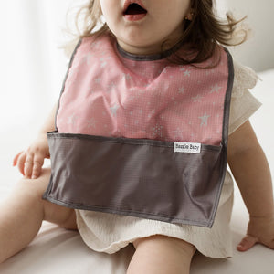 Bazzle Baby GoBib with bottom pocket to catch the mess. Bib folds into itself into a ball with a clip for easy clean up.