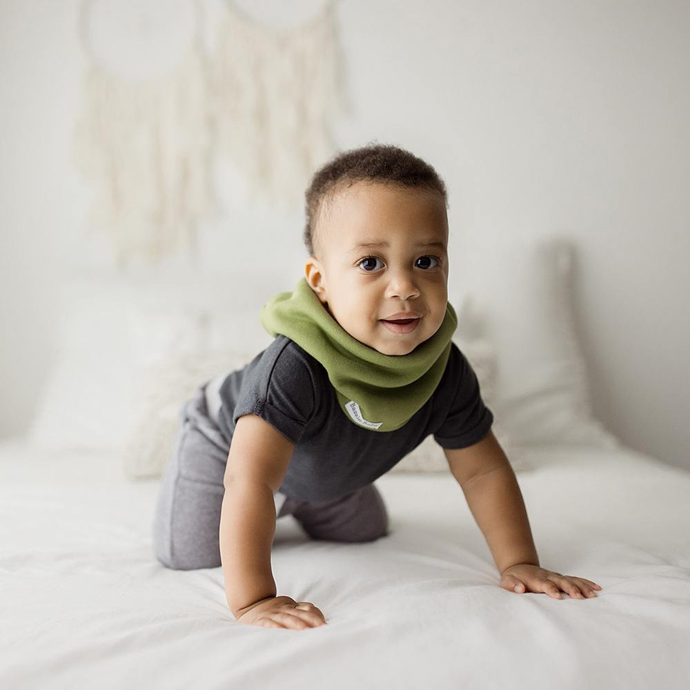 Sage and ivory baby infinity scarf style drool bib with fleece for added warmth.