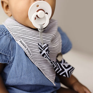 Bazzle Baby bandana drool bib with pen lines.