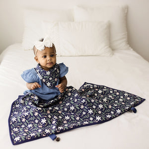 Bazzle Baby GoBlanket with four attached clips to attach to strollers, carseats, and clothing for discreet nursing. Navy floral.