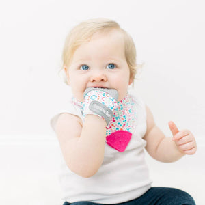 Bazzle Baby Chew Mitt in colorful watercolor dots.