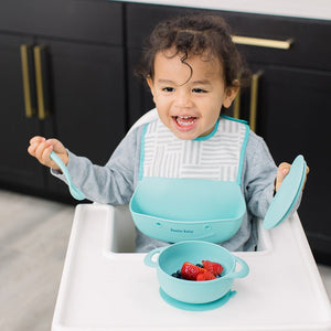 Bazzle Baby Foodie Silicone and Fabric Bib in unisex teal and white stripes.