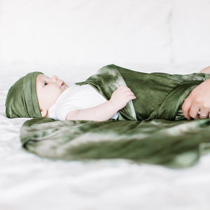 Bazzle Baby Forever Swaddle and Hat Set in olive tie-dye.