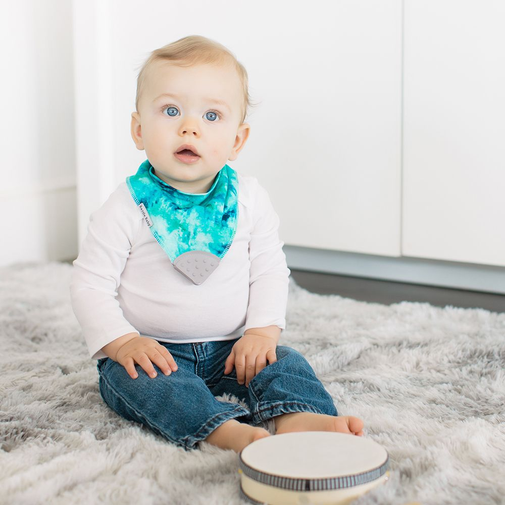 Bazzle Baby bandana bibs with teethers in tie-dye, constellations, yellow and blue stripes and denim.
