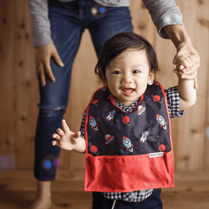 Bazzlebaby travel bib with bottom pocket and clip.